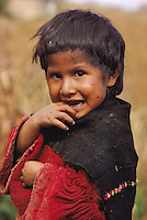 Quechua Indian girl in a hamlet of Ayata, Departamento La Paz, Provincia Munecas, in the Andes of Bolivia.