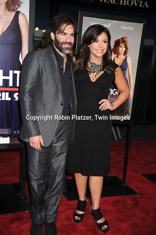 """Rachael Ray and husband John Cusimano arriving at The Premiere of """"Date Night on April 6, 2010 at the Ziegfeld Theatre in New York City. The movie stars Tina Fey, Steve Carell, Taraji P Henson, Common, and Leighton Meester."""