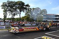 Jun 10, 2016; Englishtown, NJ, USA; NHRA top fuel driver Luigi Novelli (near) races alongside Terry McMillen during qualifying for the Summernationals at Old Bridge Township Raceway Park. Mandatory Credit: Mark J. Rebilas-USA TODAY Sports