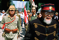 Old men in imperial army and navy uniforms march through the grounds of the  controversial Yasukuni Shrine during the celebration of the end of the Pacific War. This shrine houses the spirits of Japan's war dead, including 14 Class A war criminals,and is a source of tension for Japanese neighbors, especially China and Korea who suffered badly at the hands of the Japanese Imperial forces before and during World War 2. Yasukuni Ginja Tokyo, Japan August 15th 2007