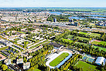 Nederland, Noord-Holland, Amsterdam, 27-09-2015; Amsterdam-Oost, Watergraafsmeer. Sportpark Middenmeer, met Jaap Edenbaan. Foto richting Science Park en IJ, landelijk Noord aan de horizon.<br /> Sport park, Amsterdam East with Ice skating rink.<br /> <br /> luchtfoto (toeslag op standard tarieven);<br /> aerial photo (additional fee required);<br /> copyright foto/photo Siebe Swart