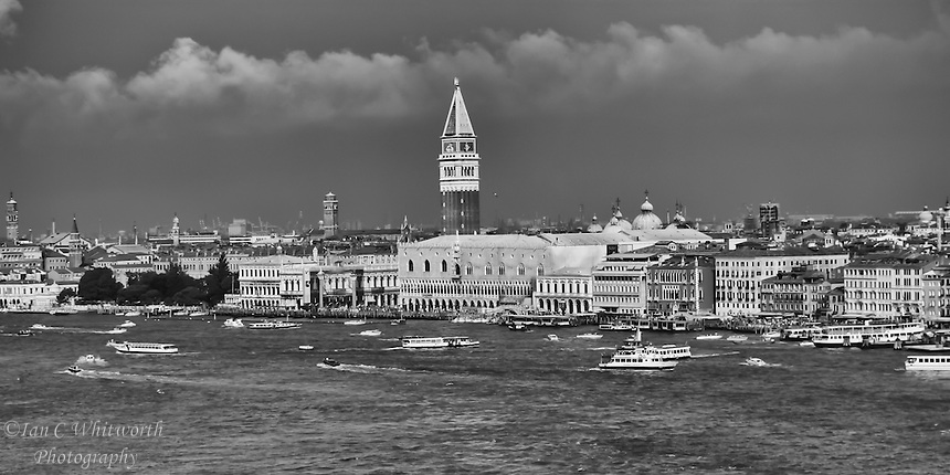 A view of the busy waters of Venice below Piazza San Marco in black and white.