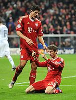 FUSSBALL   CHAMPIONS LEAGUE   SAISON 2011/2012   ACHTELFINALE RUECKSPIEL     13.03.2012 FC Bayern Muenchen - FC Basel        JUBEL nach dem TOR Mario Gomez (li,) mit Thomas Mueller (FC Bayern Muenchen)