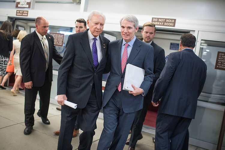 UNITED STATES - JUNE 28: Sens. Rob Portman, R-Ohio, right, and Orrin Hatch, R-Utah, make their way through the Senate subway before a vote in the Capitol, June 28, 2016. (Photo By Tom Williams/CQ Roll Call)