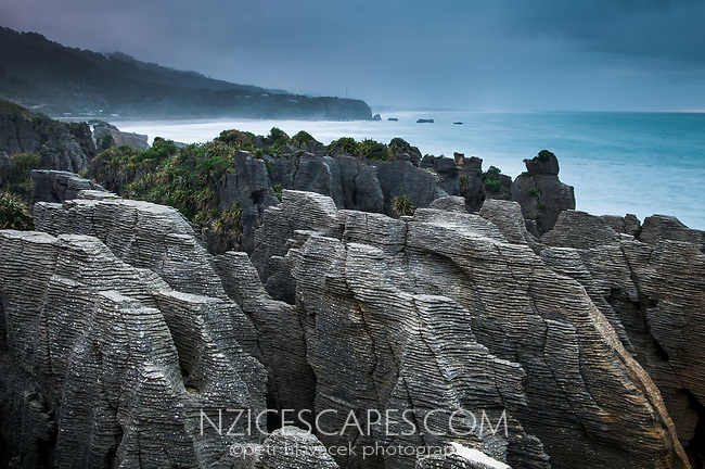 Stormy, dramatic skies in Punakaiki at pancake rocks, Paparoa National Park, Buller Region, West Coast, New Zealand, NZ
