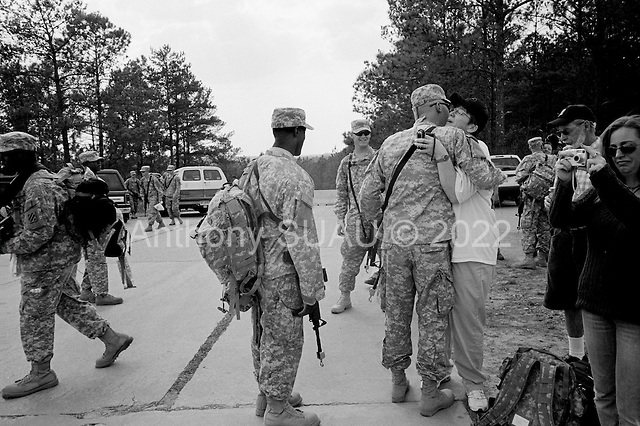 Columbus, Georgia.USA.March 12, 2007..450 soldiers of the third infantry, third brigade are deployed to Iraq from Fort Benning, Georgia. Many of the men are being deployed for their second or third tour of duty...Soldiers spent their last minutes with their families on the base before separating and boarding a bus to the base airport...Becky Johnson gives a lasting and heartfelt farewell hug to her son Private Adam Behrend before he is deployed to Iraq. His father Peter Behrend is to the right of the frame as they drove down from Wisconsin to see his off.