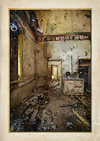 Kitchen with doorways in derelict manor house