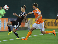 Washington D.C. - May 17, 2014:  Chris Rolfe (18) of D.C. United goes against David Horst (18) of Houston Dynamo. D.C. United defeated  the Houston Dynamo 2-0 during a Major League Soccer match for the 2014 season at RFK Stadium.