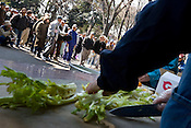 Vegetables are chopped whilst approximately 700 homeless men attend a soup kitchen run by a Korean Christian church, in Ueno Park, Tokyo, Japan, Friday 27th March 2009. The men, most of whom are long term homeless, attend the soup kitchen 4 times a week, and have to listen to a church sermon prior to being given a hot lunch, food to take away, and if they wish they can have haircuts, and obtain clothes.