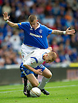Rangers v St Johnstone....28.08.10  .Liam Caddis is fouled by Vladimir Weiss.Picture by Graeme Hart..Copyright Perthshire Picture Agency.Tel: 01738 623350  Mobile: 07990 594431
