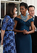 (L-R) Samantha Cameron, First lady Michelle Obama and British Prime Minister David Cameron greet one another on the North Portico of the White House March 14, 2012 in Washington, DC. Cameron is on a three-day visit to the U.S. and he was expected to have talks with Obama on the situations in Afghanistan, Syria and Iran.  .Credit: Chip Somodevilla / Pool via CNP