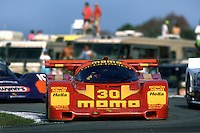 DAYTONA BEACH, FL - FEBRUARY 4: The MOMO Porsche 962C 001GS of Gianpiero Moretti, Derek Bell, Steve Phillips, Costas Los and Stanley Dickens is driven during the 24 Hours of Daytona IMSA GT race at the Daytona International Speedway in Daytona Beach, Florida, on February 4, 1990.