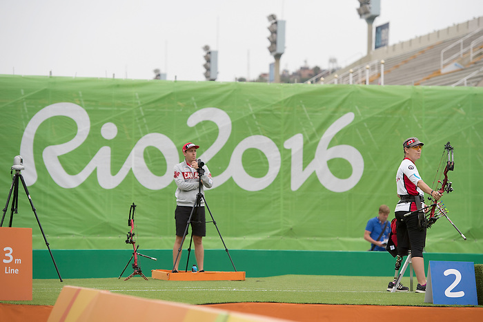 RIO DE JANEIRO - 16/9/2016:  Philip Henderson coach of Karen van Nest looks on as she competes in the Women's Ind. Compound - Open 1/8 Elimination Match the Sambodromo during the Rio 2016 Paralympic Games in Rio de Janeiro, Brazil. (Photo by Matthew Murnaghan/Canadian Paralympic Committee)