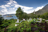 Calvary Cemetery overlooking Atuona Bay, where the French artist Paul Gauguin, 1848-1903, and the Belgian singer Jacques Brel, 1929-78, are buried, on the island of Hiva Oa, in the Marquesas Islands, French Polynesia. Picture by Manuel Cohen