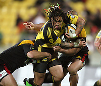 Ma'a Nonu runs into the tackle of Chiefs props Nathan White and Sona Taumalolo during the Super 14 rugby match between the Hurricanes and Chiefs at Westpac Stadium, Wellington, NewZealand on Saturday, 1 May 2010. Photo: Dave Lintott / lintottphoto.co.nz
