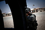 "10/4/2010 FOB Dwyer, Helmand Province, Afghanistan.SPC Matt Good, a Medevac Crew Chief with Charlie Co. 6-101st Aviation Wing, prepares to go on a ""CAT Alpha"" mission--one in which the patient must be picked up as soon as possible due to their critical condition...The Helicopter Medevac teams of Task Force Destiny, based at Forward Operating Base Dwyer in Afghanistan's war-torn Helmand Province have a tough job. Servicing a large area that includes still restive southern Marjah, and much of the Helmand River Valley, TF Destiny answers the call to transport gravely wounded US Marines and Afghan civilians from the point of injury in the field to Role 3 trauma centers on bases in the area--often times landing under fire to extract Marines and soldiers that would otherwise succumb to their wounds. After the Medevac helicopter and it's ""chase"" UH-60 Blackhawk companion aircraft get a call, they can be on the ground picking up a patient in as little as 20 minutes--delivering the fallen to a surgical theater within what flight medics refer to as ""the golden hour""--or the hour after a catastrophic injury during which a patients transfer from basic battlefield triage care to a modern trauma surgical unit can mean the difference between life and death. ."