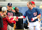 28 September 2010: Washington Nationals' infielder Adam Kennedy signs autographs prior to a game against the Philadelphia Phillies at Nationals Park in Washington, DC. The Nationals defeated the Phillies 2-1 on an Adam Dunn walk-off solo homer in the 9th inning to even up their 3-game series one game apiece. Mandatory Credit: Ed Wolfstein Photo
