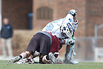 14 February 2015: North Carolina's Stephen Kelly (24) wins a faceoff against UMass's Charlie Schatz (6). The University of North Carolina Tar Heels hosted the University of Massachusetts Minutemen in a 2015 NCAA Division I Men's Lacrosse match. UNC won the game 20-8.