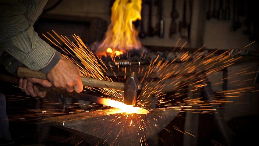 STILL FROM VIDEO 1920x1080<br /> Blacksmith Gordon Gearhart hammers molten metal in his shop in Marquette, Michigan.
