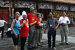 Members of the 2013 Veterans For Peace Tour stand outside the Mieu Temple in the Citadel in the former imperial capital of Hue, Vietnam. April 21, 2013.