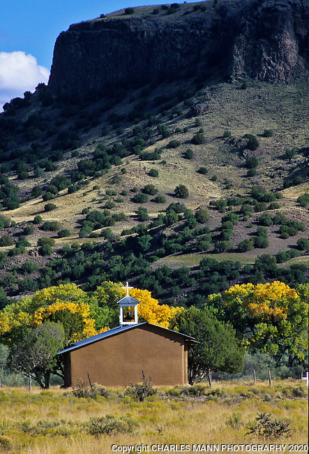 An old church at the base of Black Mesa on  San Ildefonso Pueblo lends a romantic and mysterious air to the fall colors and looming shape of the mesa.