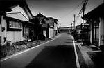 The commercial center of the veritable ghost town of Kawauchi Village, which sits right on top of the 20 km (12.4 miles) nuclear no-entry zone line, and the police check point is less than 200 m to the left.  Less than two weeks ago, half of the village was within the exclusion zone but the police check point has been moved back to the edge of the village.  It still sits within the 30 km (18.6 miles) voluntary evacuation zone where residents are encouraged to stay indoors and be ready for immediate evacuation if necessary.  Important crossroads between Koriyama in the main central valley and Iwaki a seaside harbor town, pass through this isolated mountain village.  Some villagers have begun to return but the village remains a ghost town.   Fukushima Prefecture, Japan.