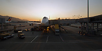 A British Airways 747 at Hong Kong's Chep Lap Kok airport, late afternoon as the sun sets behind
