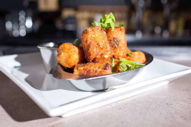Raleigh, North Carolina - Wednesday February 24, 2016 - House tater tots at The Oak in Raleigh.