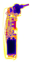 An X-ray of an Electronic Thermometer.  This type of electronic thermometer uses an infra-red sensor that detects the heat from a body.  The unit uses a 9 volt battery located at the bottom.  The heat sensor is at the top of this image.