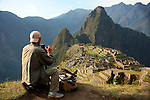 South America, Peru. Photographer at Machu Picchu, a UNESCO World Heritage Site.