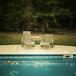 Swimming pool with two lounge chairs
