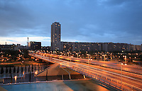 Cityscape of Valencia, Communitat Valenciana, Spain at twilight with a large bridge and evening traffic. Picture by Manuel Cohen