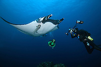 QT1926-D. Manta Ray (Manta birostris) interacts with underwater photographer (model released). Baja, Mexico, Pacific Ocean.<br /> Photo Copyright &copy; Brandon Cole. All rights reserved worldwide.  www.brandoncole.com