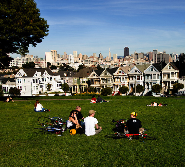 California, San Francisco: Bicyclists relaxing at Alamo Square..Photo #: 20-casanf77598.Photo © Lee Foster 2008