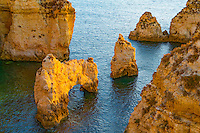 Sea arch at sunrise near Lagos, Portugal, Atlantic Ocean