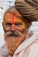 Pashupatinath, Nepal.  Sadhu (Holy Man) at Nepal's Holiest Hindu Temple, Having a Good Hair Day.  The trident on his forehead marks him as a devotee of Shiva.
