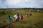 Dominican Republic: Musicians and locals of the Bateys (plantations) file through the fields at the end of the GaGá  procession of El GaGá de San Luis on the outskirts of Santo Domingo...