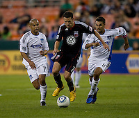 Geovanni (77) and Chris Wondolowski (8) of San Jose try to catch up to Carlos Varela (11) of D.C. United during a game at RFK Stadium in Washington, DC.  San Jose defeated D.C. United, 2-0.