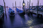 Time Exposure of Gondolas Tied up in the Evening at Piazza San Marcos, Venice, Veneto, Italy