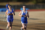Oxford Middle School's Emily Hawkins (right) runs in a track meet at Oxford High School on Thursday, March 11, 2010.