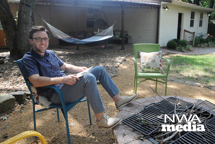 NWA Democrat-Gazette/FLIP PUTTHOFF<br /> Brock Short enjoys spending time    Sept. 8 2015   at his back-yard campfire area or relaxing in his hammock.
