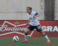 USWNT defender Rachel Buehler (19) controls the ball. In an international friendly, the U.S. Women's National Team (USWNT) (white/blue) defeated Korea Republic (South Korea) (red/blue), 4-1, at Gillette Stadium on June 15, 2013.