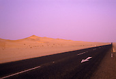 Dunes and road at dusk through the Namib Naukluft Park near Swakopmund, Namibia, Africa
