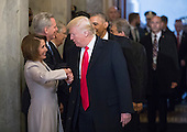 United States President-elect Donald Trump greets US House Minority Leader Nancy Pelosi (Democrat of California), and other Congressional leaders as he arrives for his inauguration ceremony on Capitol Hill in Washington, Friday, Jan. 20, 2017.<br /> Credit: J. Scott Applewhite / Pool via CNP