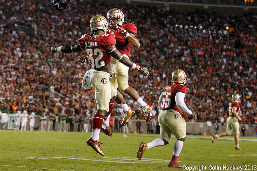 TALLAHASSEE, FL 11/2/13-FSU-MIAMI110213CH-Florida State's James Wilder, Jr., left, celebrates his touchdown with Devonta Freeman during first half action of the Miami game Saturday at Doak Campbell Stadium in Tallahassee. <br /> COLIN HACKLEY PHOTO