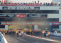 Sep 24, 2016; Madison, IL, USA; NHRA top fuel driver Steve Torrence (left) races alongside Leah Pritchett during qualifying for the Midwest Nationals at Gateway Motorsports Park. Mandatory Credit: Mark J. Rebilas-USA TODAY Sports