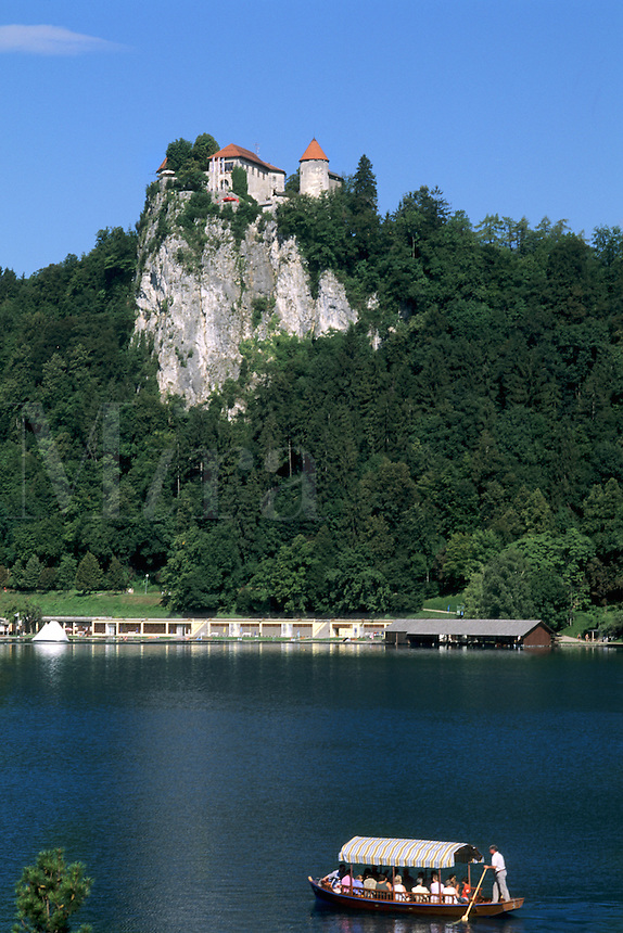 Slovenia Lake Bled Famous Castle and Small boat in resort town of Bled Slovenia