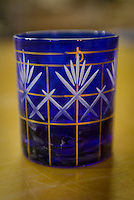 A glass in the early stages of cutting. Shimizu Glass, Tokyo, Japan, January 14, 2015. Edokiriko is a style of cut glass that dates back to 1834 and is similar to British cut glass. It makes use coloured glass and highly-intricate Japanese motifs.