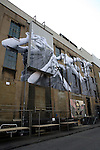 "Huge blow-up, by the French street artist JR, called the ""photograffeur"", Truman Brewery, Brick Lane, London"