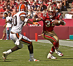 Cleveland Browns defensive back Earl Little (20) moves in to stop San Francisco 49ers running back Kevan Barlow (32) on Sunday, September 21, 2003, in San Francisco, California. The Browns defeated the 49ers 13-12.